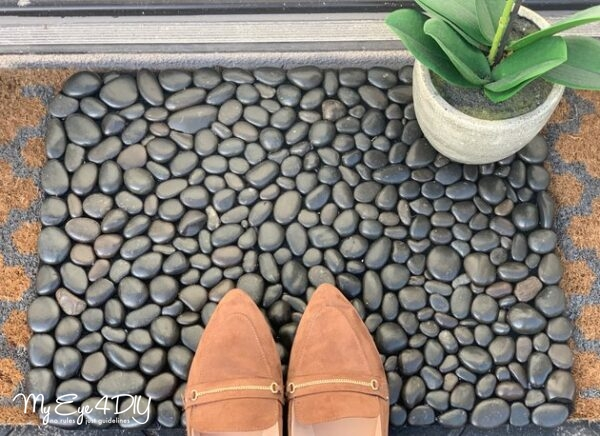 DIY doormat using river rocks